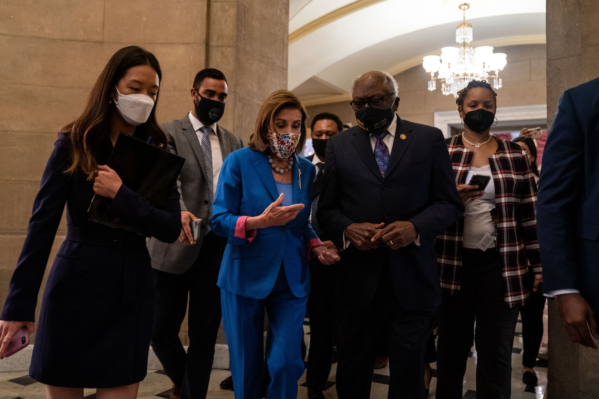 Nancy Pelosi, James Clyburn and others walk through the halls of the Capitol