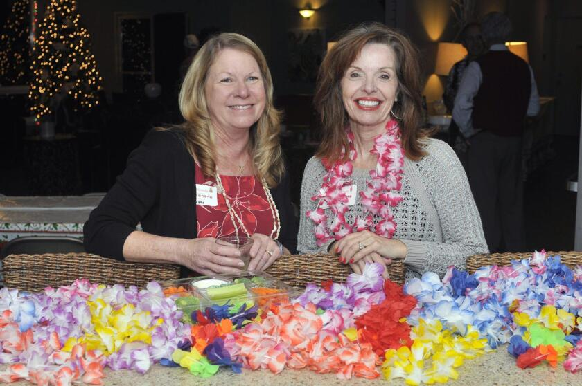 Board member/holiday party co-chair Linette Page, board member Gayle Valentino