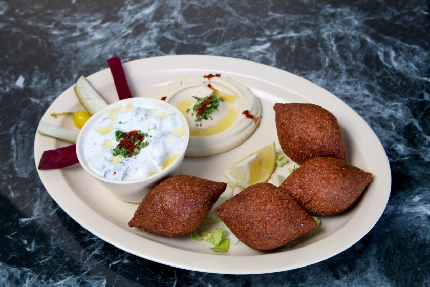 Fried kobee, hummus and yogurt with cucumber at the Kobee Factory & Syrian Kitchen.