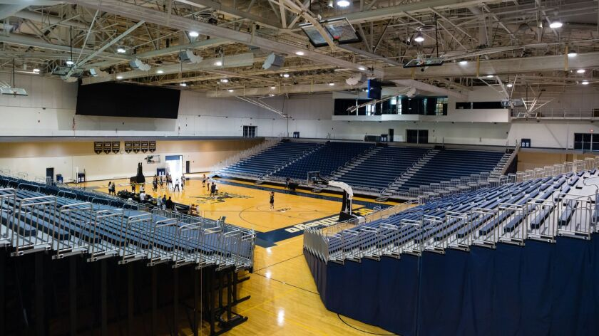The renovations at UCSD's RIMAC Arena include all new bleacher and chair seating, a large video board (upper left) and enlarged sky box (upper right).