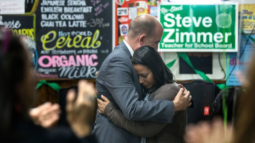 LAUSD board president and incumbent District 4 member Steve Zimmer, left, embraces Anika Fernandez,