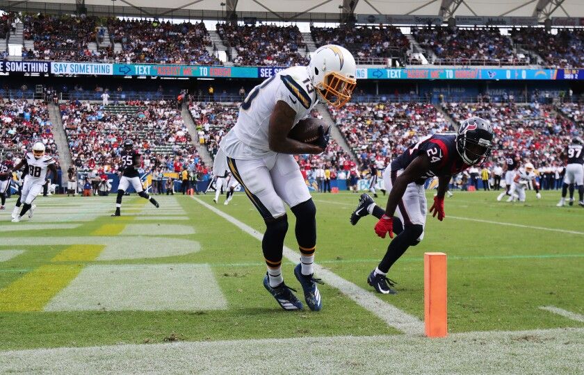 Chargers wide receiver Keenan Allen keeps his feet inbounds for a seven-yard touchdown reception.