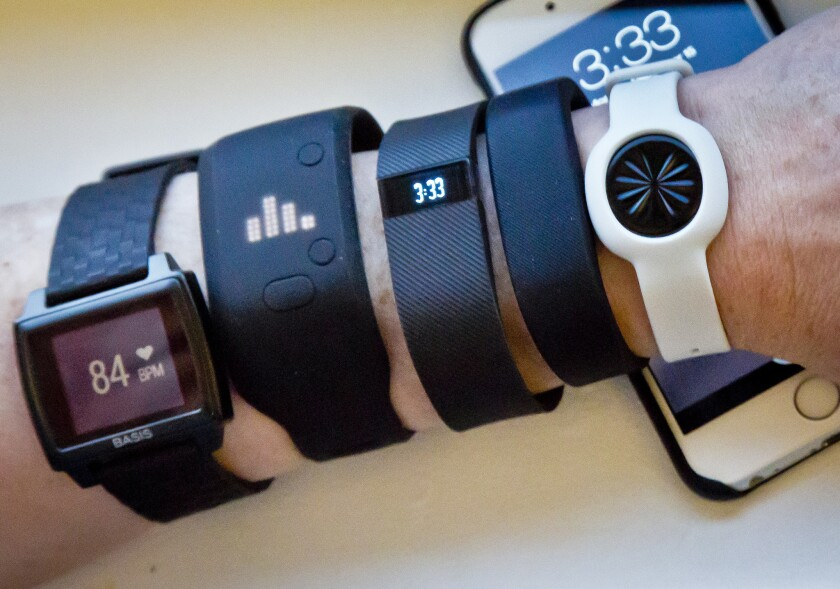 Some smartphone apps proved to be about as accurate at counting steps as several fitness trackers, according to a new study. Updated models, such as those shown here in December, were not tested, and no marks were given for other functions the devices and apps track.