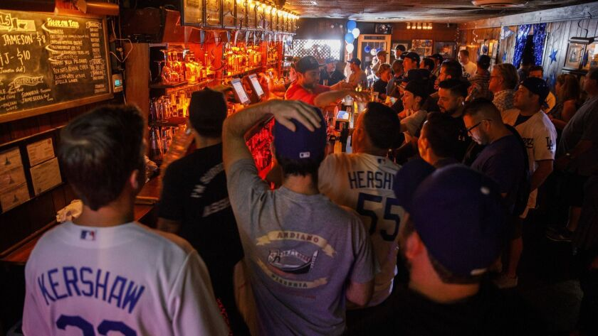 Dodgers fans gather at The Short Stop bar in Echo Park before World Series Game 3 game against the Boston Red Sox.