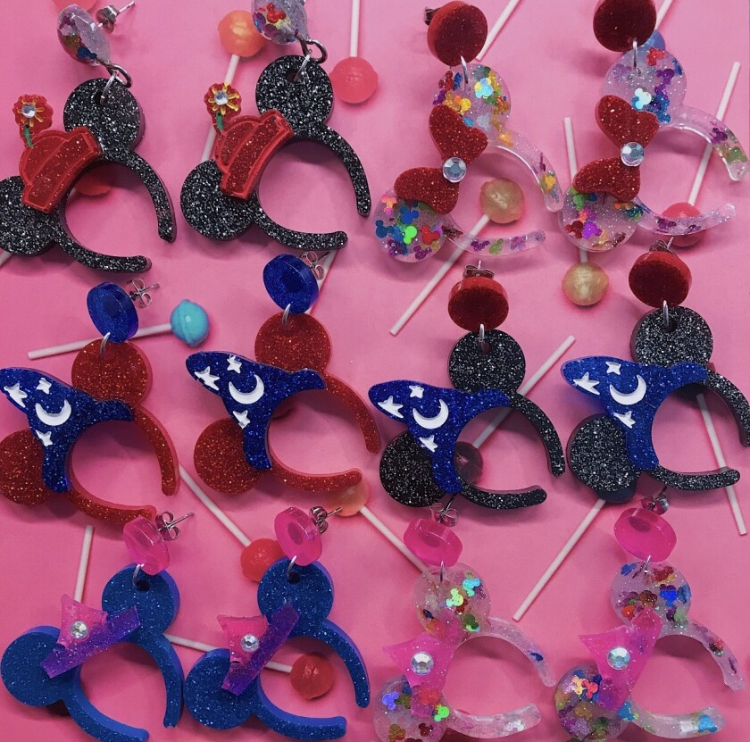 Mickey and Minnie Mouse earrings.