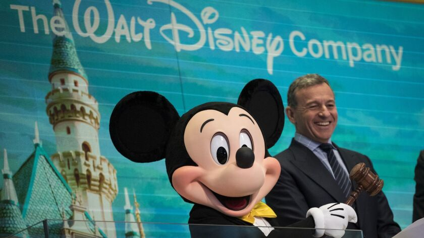 Mickey Mouse and Walt Disney Co. Chief Executive Bob Iger prepare to ring the opening bell at the New York Stock Exchange in November 2017.