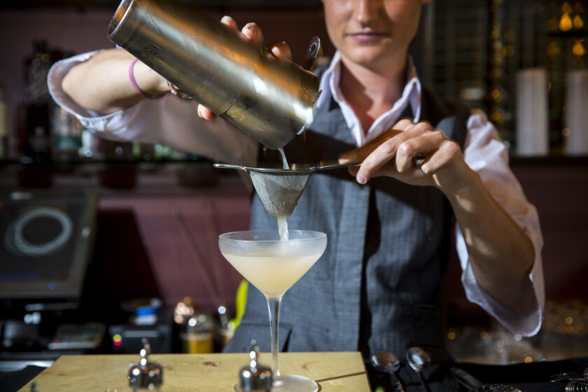According to a new survey, 70% of millennials would date a mixologist. Pictured is a bartender from Providence in Los Angeles making a drink.