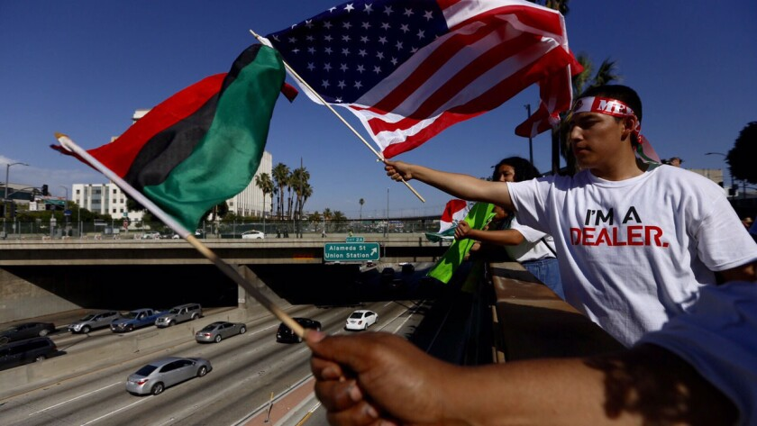 Moises Cuevas and other participate in a May Day march in downtown Los Angeles.