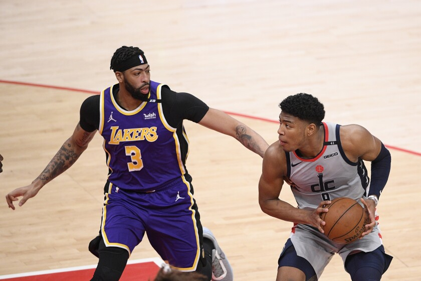 Wizards forward Rui Hachimura in action against Anthony Davis during the first half.