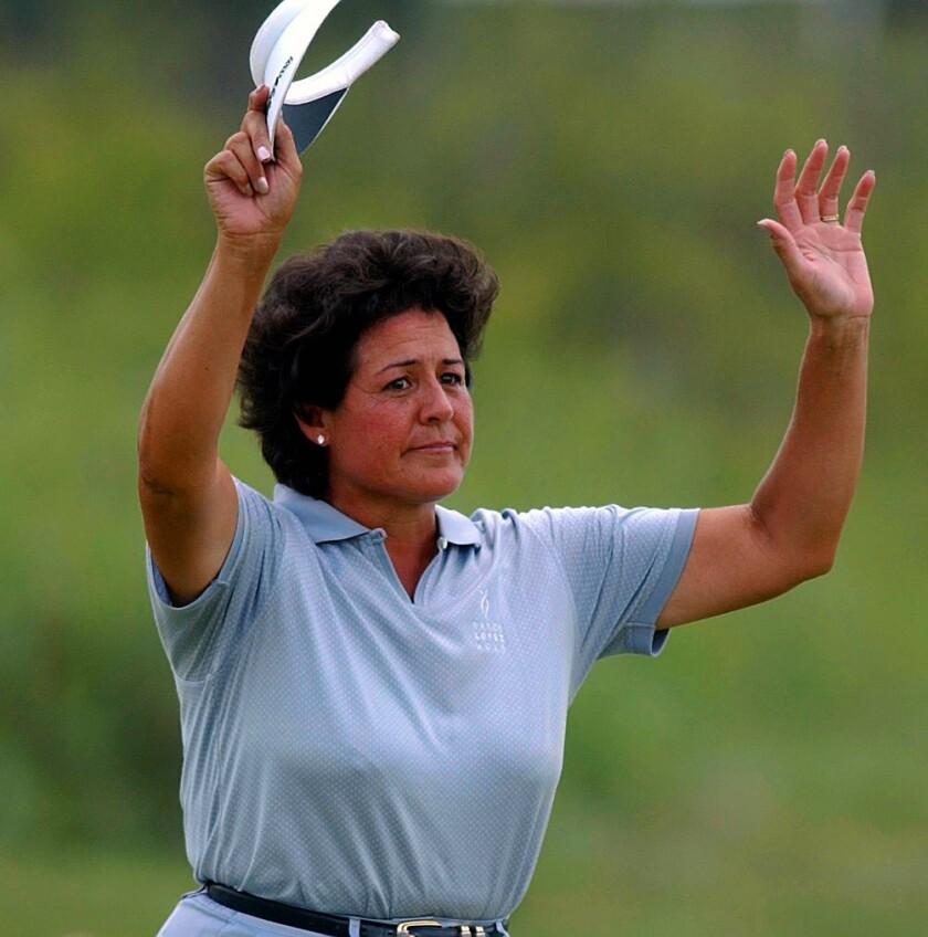 Nancy Lopez waves to fans.