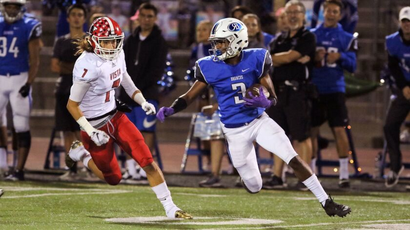 Rancho Bernardo's Angelo Ducksworth carries the ball after he intercepted a pass meant for Vista receiver Zack Spayde, at left.