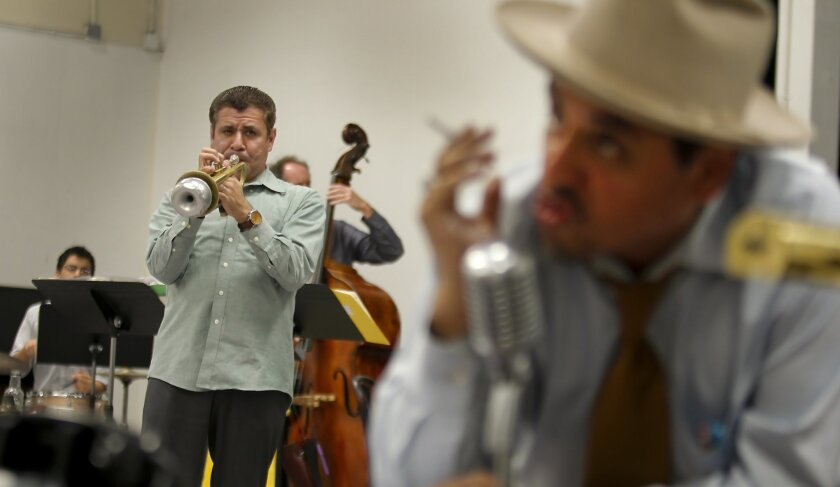 """Gilbert Castellanos (left) and Richard Montoya rehearse the first scenes of """"Federal Jazz Project"""" at a San Diego Rep rehearsal."""