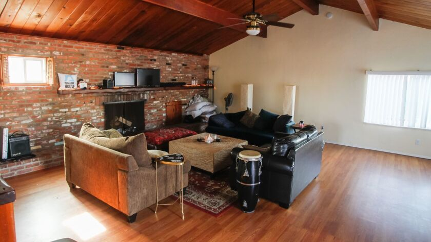 The living room in the Moishe House in Oceanside is large enough for a party and has a conga drum and karaoke machine for musical celebrations.