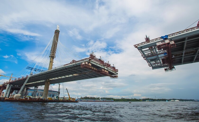 beautiful cable-stayed bridge in the construction process. summer. the view from the water