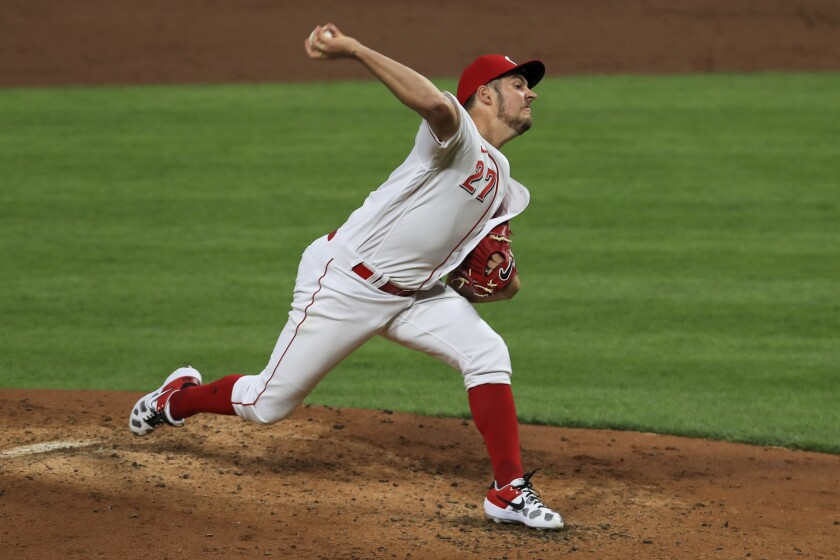 FILE - In this Sept. 19, 2020, file photo, Cincinnati Reds' Trevor Bauer throws in the third inning during a baseball game against the Chicago White Sox in Cincinnati. Game 1 of a National League wild-card baseball series between the Braves and Cincinnati Reds is Wednesday, Sept. 30. (AP Photo/Aaron Doster, File)
