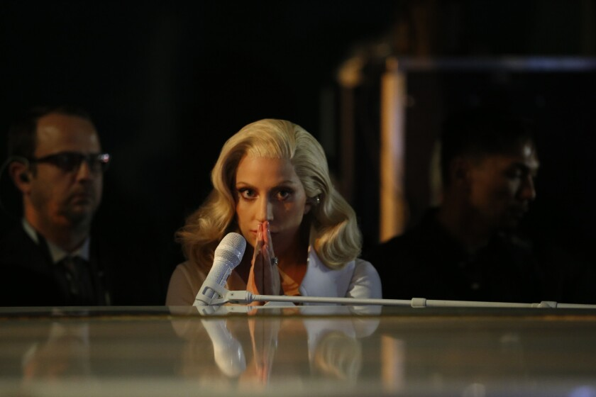 Lady Gaga, shown backstage at the 88th Academy Awards in February, is releasing her newest on Oct. 21.