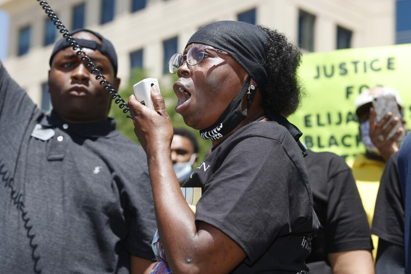 In this June 27, 2020 photo, Sheneen McClain speaks during a rally and march over the death of her son, Elijah McClain.