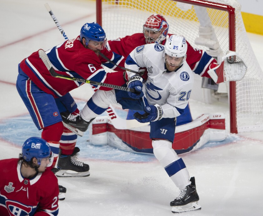 Montreal Canadiens' Shea Weber (6) clears Tampa Bay Lightning's Blake Coleman (20) in front of Canadiens goaltender Carey Price (31) during the first period of Game 4 of the NHL hockey Stanley Cup final in Montreal, Monday, July 5, 2021. (Ryan Remiorz/The Canadian Press via AP)