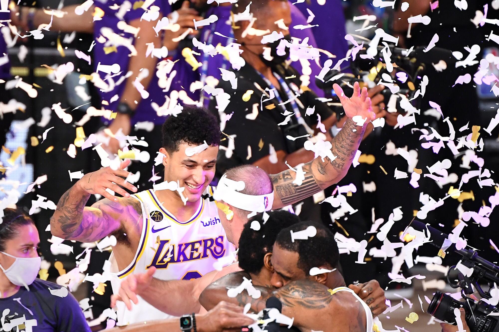 Kyle Kuzma and his Lakers teammates celebrate winning the 2020 NBA championship.