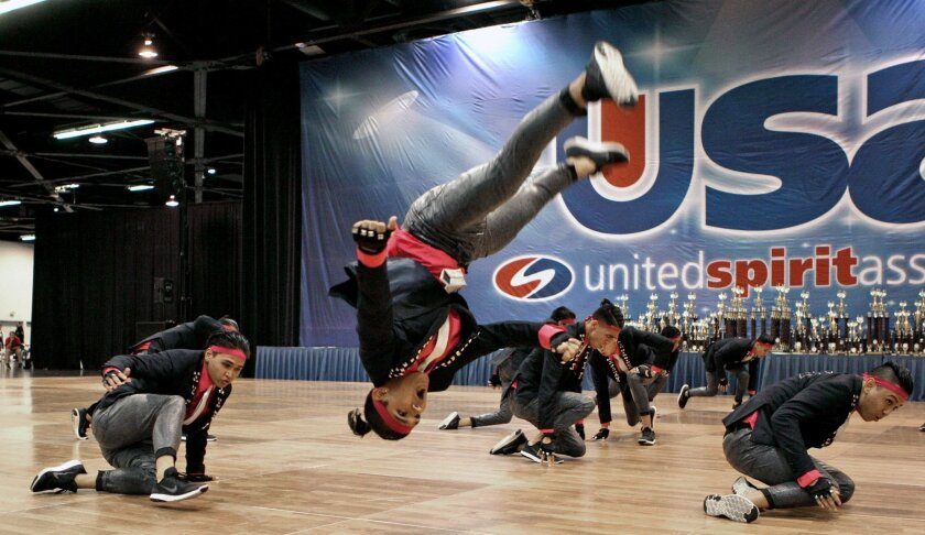 Andrew Garcia flips during the all-male routine during USA Nationals.