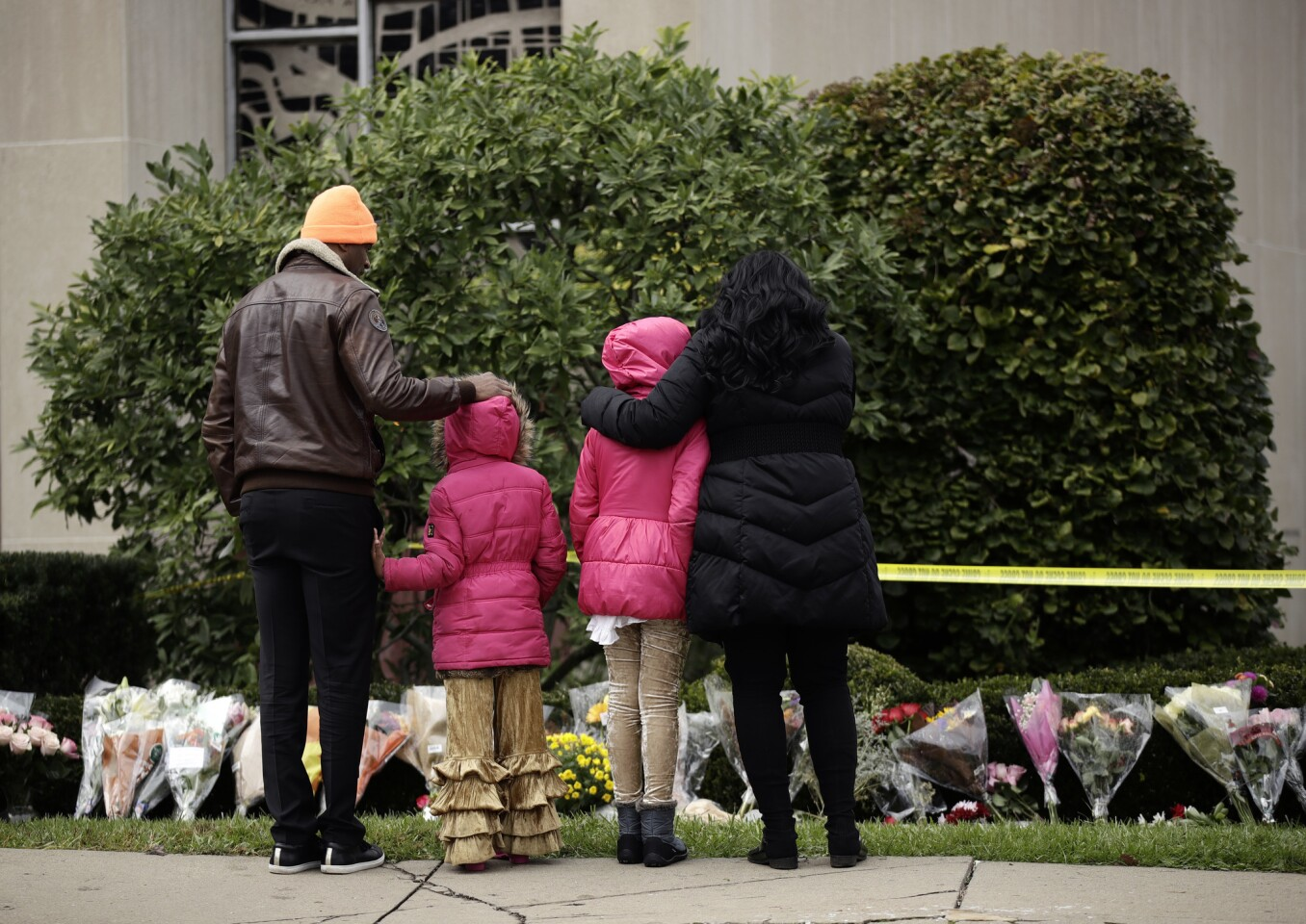 Mourners view a row of flowers at a memorial for the victims of the Tree of Life Synagogue shooting in Pittsburgh on Sunday.