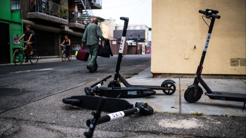 VENICE, CA - July 25, 2018 Bird electric scooters sit discarded in an alleyway near the Venice Beach