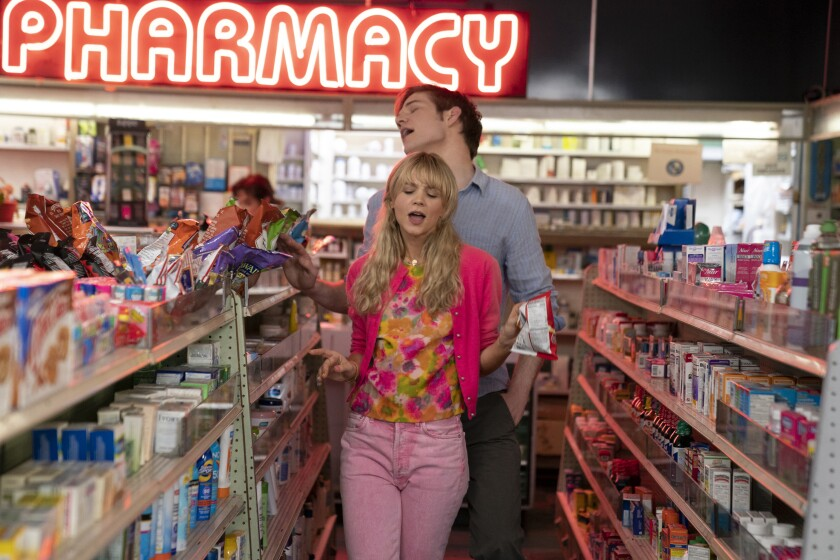 """Carey Mulligan as Cassie and Bo Burnham as Ryan play around in a store in """"Promising Young Woman."""""""