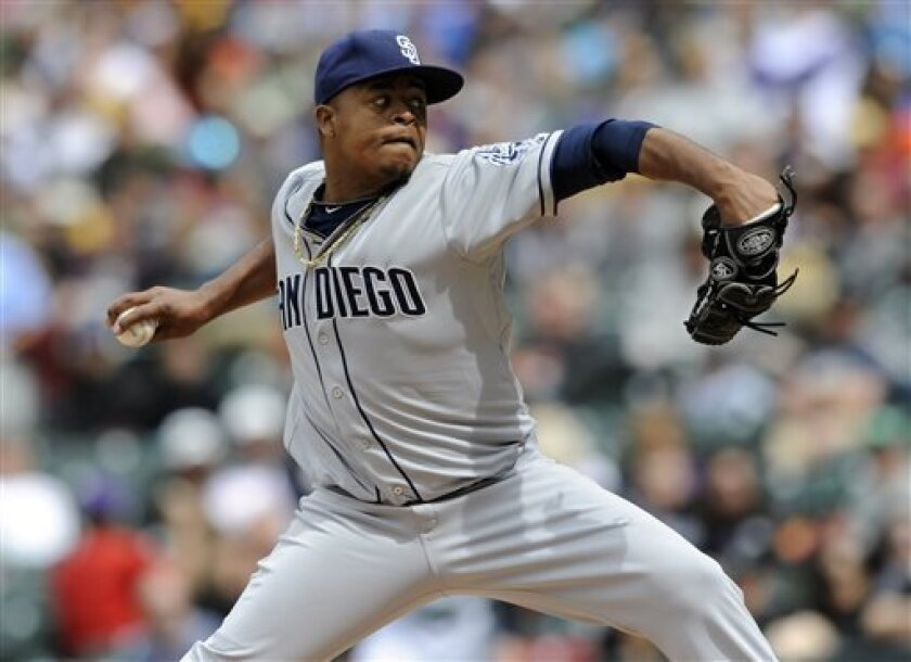 San Diego Padres starting pitcher Edinson Volquez throws to the plate against the Colorado Rockies during the first inning of an MLB baseball game on Sunday April 7, 2013, in Denver. (AP Photo/Jack Dempsey)