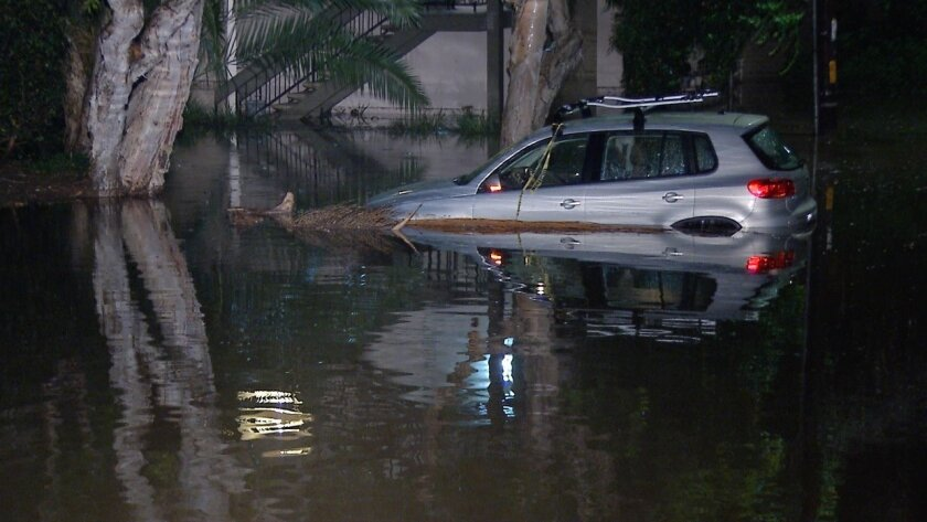 Flooding on Torrance Street, near Reynard Way, in Mission Hills. /Greg Torkelson / San Diego News Video