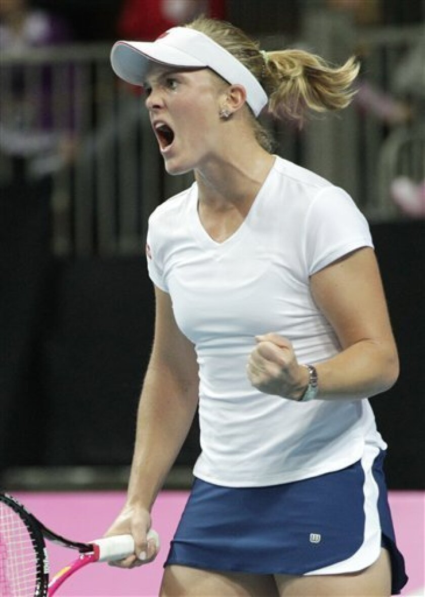 US player Melanie Oudin reacts during the World Group Fed Cup match against Belgium in Antwerp, Belgium, Saturday, Feb. 5, 2011. Belgium leads on the first day 2-0. (AP Photo/Yves Logghe)