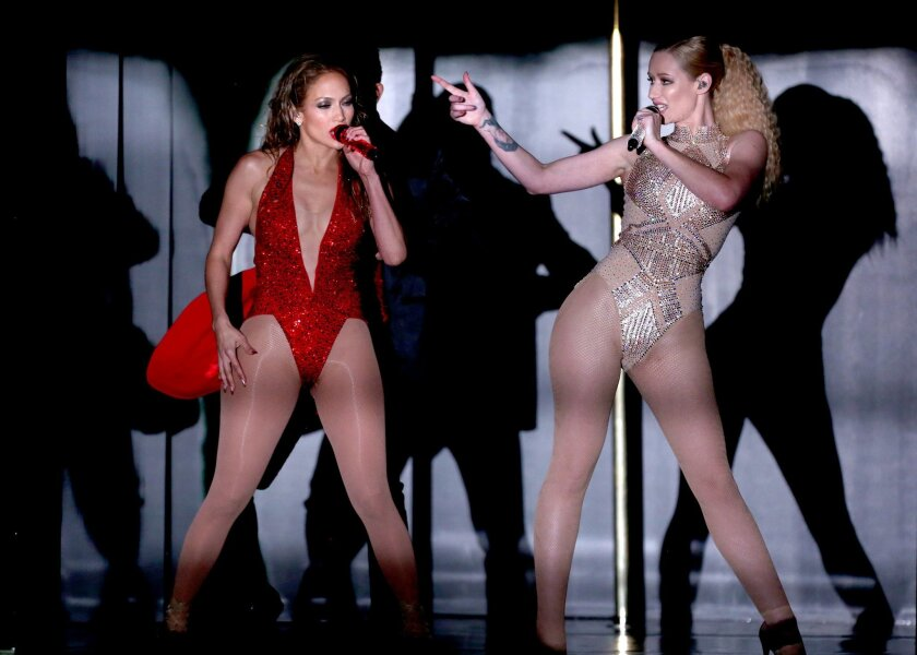 Jennifer Lopez, left, and Iggy Azalea perform at the 42nd annual American Music Awards at Nokia Theatre L.A. Live on Sunday, Nov. 23, 2014, in Los Angeles. (Photo by Matt Sayles/Invision/AP)
