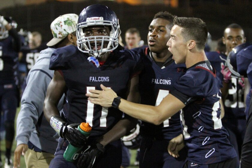 Scripps Ranch receiver Jay Numanlia-wone (left) is congratulated by his Falcons teammates after catching the winning touchdown.