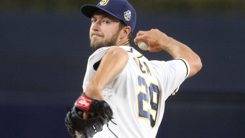The Padres' Colin Rea pitches to the Pirates in the first inning.