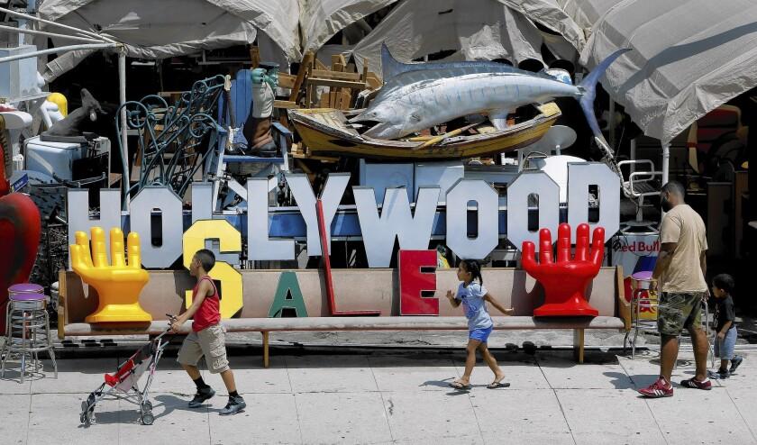 Pedestrians make their way past Nick Metropolis' store on South La Brea Avenue in Los Angeles.
