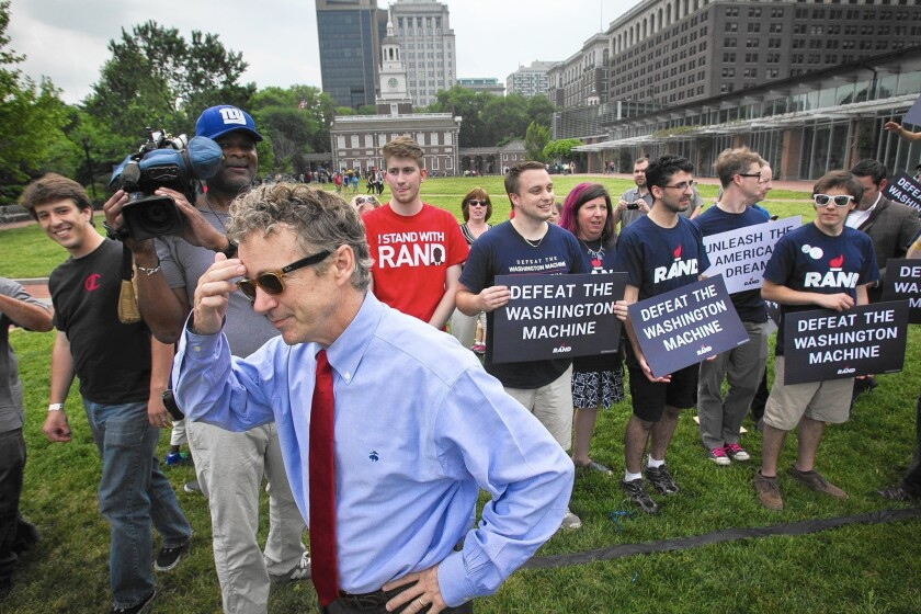 Sen. Rand Paul, talking with supporters in Philadelphia, has threatened a filibuster to block renewal of a controversial NSA spy program.