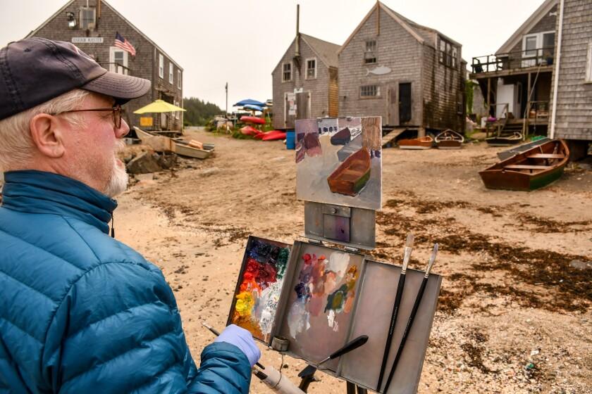 Painters on a beach at Monhegan Island, Maine.