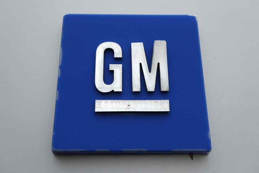 FILE - This Jan. 27, 2020 file photo shows a General Motors logo at the General Motors Detroit-Hamtramck Assembly plant in Hamtramck, Mich. General Motors says it's building a huge new electric vehicle battery lab in Michigan. There scientists will work on chemistry to cut costs 60% over current vehicles and allow people to travel 500 to 600 miles per charge. Structural steel already is in place for the 300,000-square-foot lab on the grounds of GM's Technical Center in the Detroit suburb of Warren. (AP Photo/Paul Sancya, File)