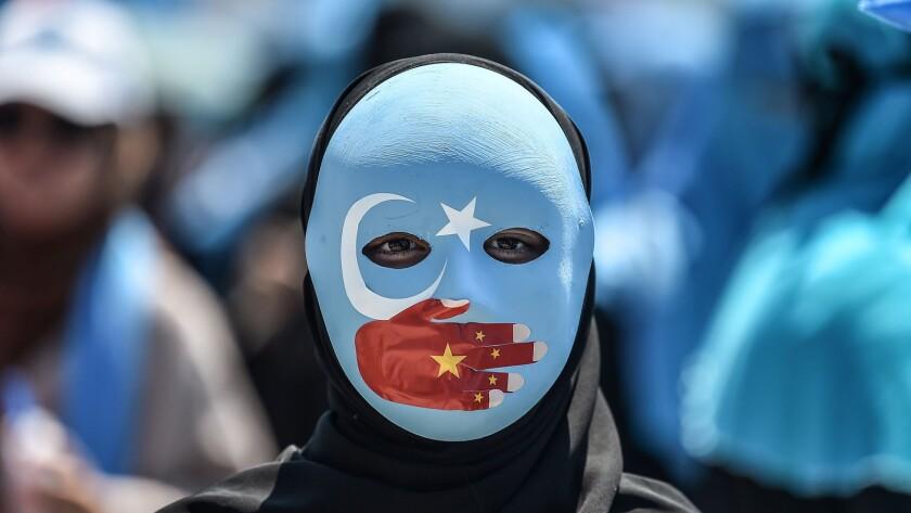 TOPSHOT-TURKEY-CHINA-UIGHUR-DEMO