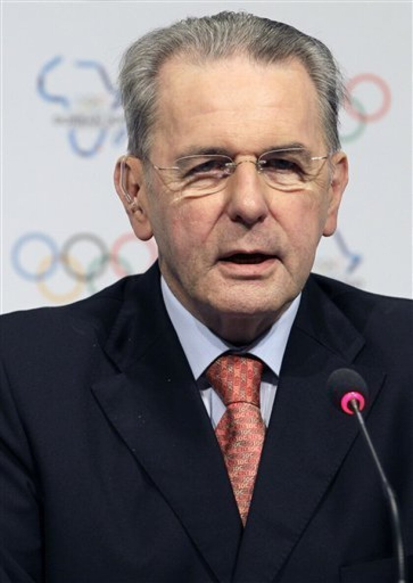 """International Olympic Committee President Jacques Rogge addressis journalist at the end of the 123rd IOC Session in Durban, South Africa, Saturday July 9, 2011. Rogge says he would be """"delighted"""" if the United States decides to bid for the 2020 Summer Olympics. (AP Photo/Themba Hadebe)"""