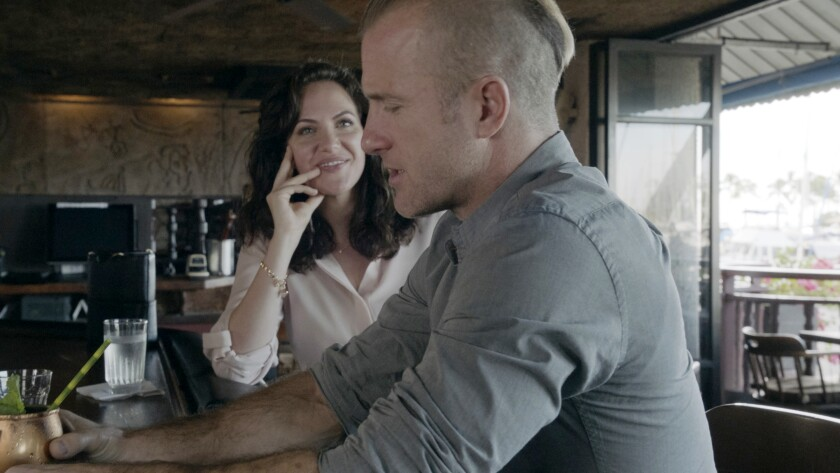 "Kate Siegel and Scott Caan in a new episode of the police drama ""Hawaii Five-0"" on CBS."