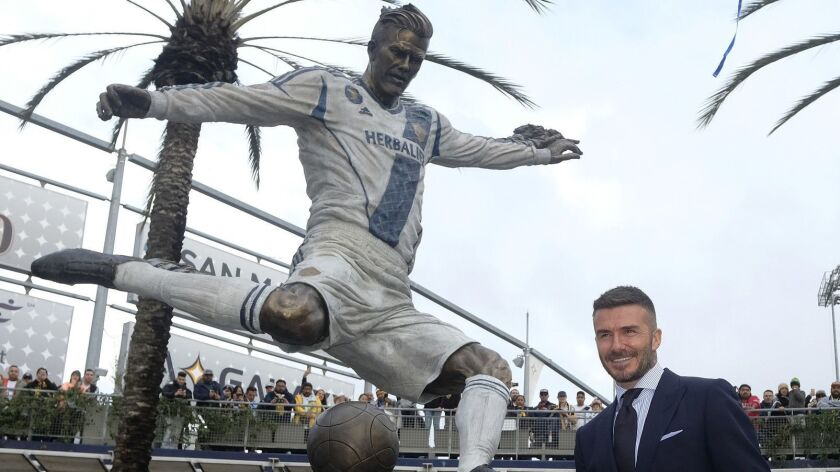 David Beckham poses with the newly unveiled statue — the real one — in front of Dignity Health Sports Park in Carson on March 2.