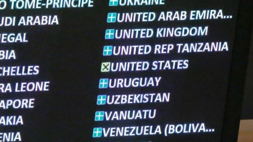 An electronic display at United Nations headquarters Wednesday shows the United States abstaining in a U.N. vote against the embargo on Cuba, a resolution the U.S. has always opposed.