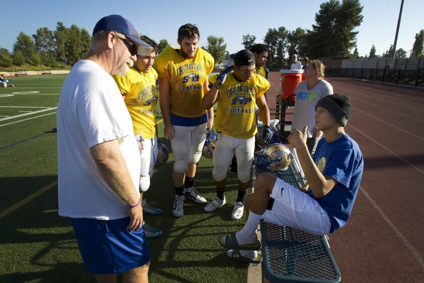 San Pasqual coach Tony Corley (left to right) and players Sebastian Tengan, Kyle Hendrickson and Peter Ricardez share time at practice Wednesday with Jesse Crowder, who recently underwent surgery for cancer in his leg.