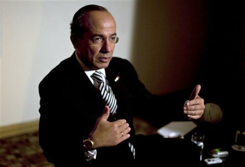 Mexico's President Felipe Calderon speaks during an interview with The Associated Press in Tijuana, Mexico, Thursday, Oct. 7, 2010. (AP Photo/Guillermo Arias)