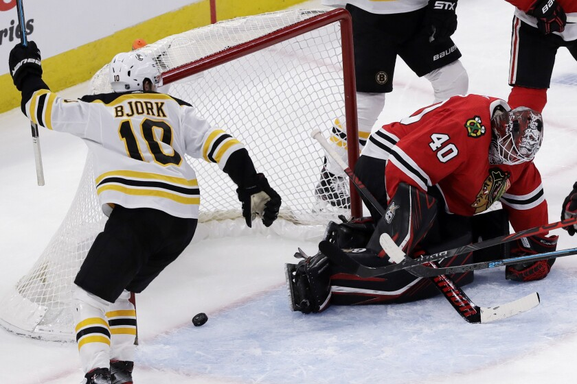 Boston Bruins left wing Anders Bjork, left, celebrates after center Sean Kuraly scored on Chicago Blackhawks goalie Robin Lehner during the second period of an NHL hockey game in Chicago, Wednesday, Feb. 5, 2020. (AP Photo/Nam Y. Huh)