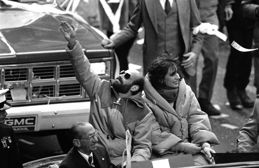 Former hostage Barry Rosen, with wife Barbara, waves as thousands cheer at a welcoming parade in New York on Jan. 30, 1981.