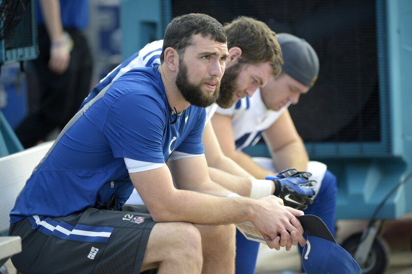 FILe - In this Dec. 13, 2015, file photo, Indianapolis Colts quarterback Andrew Luck (12), tight end Jack Doyle, center, and long snapper Matt Overton sit on the bench during the second half of an NFL football game against the Jacksonville Jaguars in Jacksonville, Fla. Colts general manager Ryan Grigson said Thursday, Feb. 25, 2016, that Andrew Luck should be healthy enough to participate in this season's offseason workouts. (AP Photo/Phelan M. Ebenhack, File)