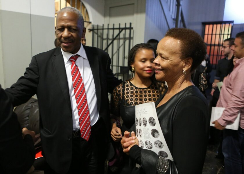 """In this photo taken Thursday, March 17, 2016, former anti-aparthied leader Mathews Phosa, left, and Limpho Hani, right, widow of assassinated anti-apartheid leader Chris Hani attend the Old Fort Prison, during an event, in Johannesburg, South Africa. Speaking in an old fort and prison from South Africa's era of white domination, a former anti-apartheid leader hinted that he would like to see the country's scandal-hit president quit by referring to the 1974 resignation of U.S. President Richard Nixon. """"I wish we can have a long nightmare over in this country,"""" said Mathews Phosa, echoing a similar phrase by Gerald Ford, the vice president who replaced Nixon after the Watergate scandal. (AP Photo/Denis Farrell)"""