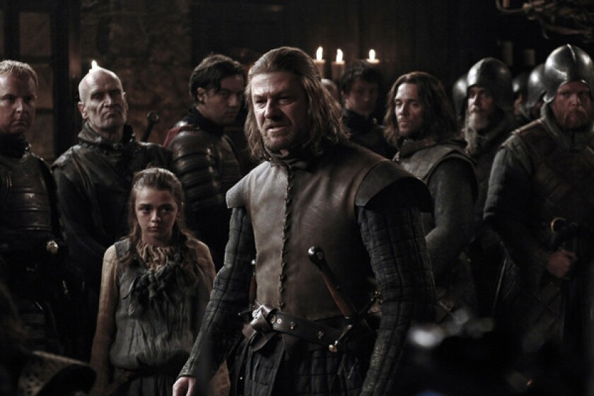 Were they ever that young? That's eventual heroine Arya Stark (Maisie Williams) back there behind the series' apparent lead, Ned Stark (Sean Bean)