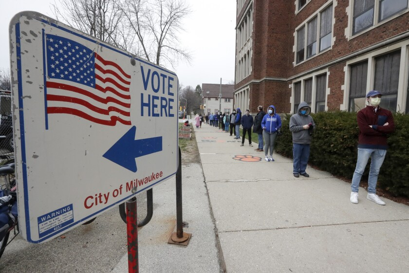 Voters line up at one of just five polling places open in Milwaukee for Wisconsin's primary election.